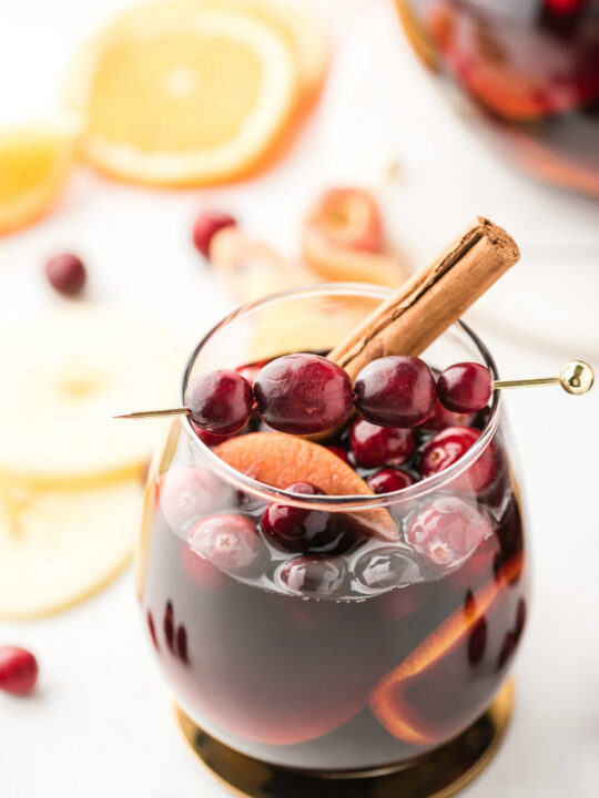 glass of apple cranberry sangria