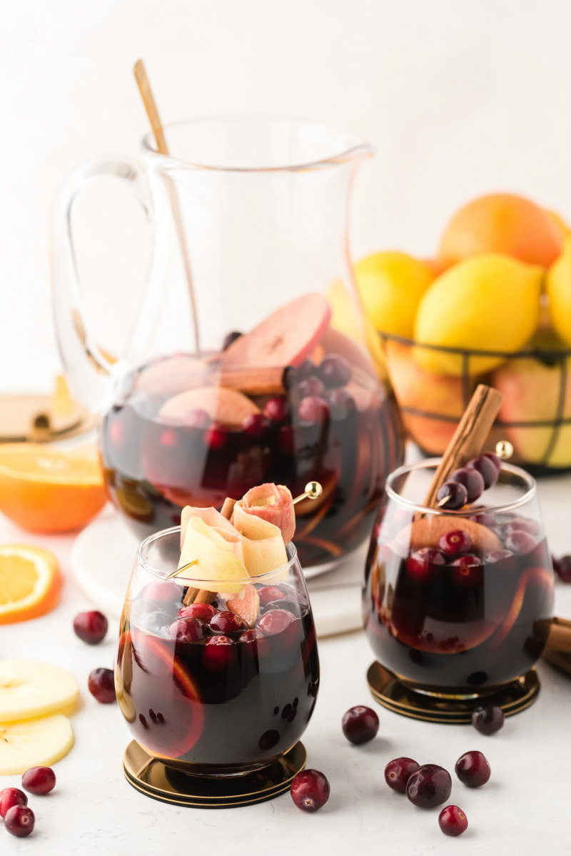 pitcher with two glasses of apple cranberry sangria
