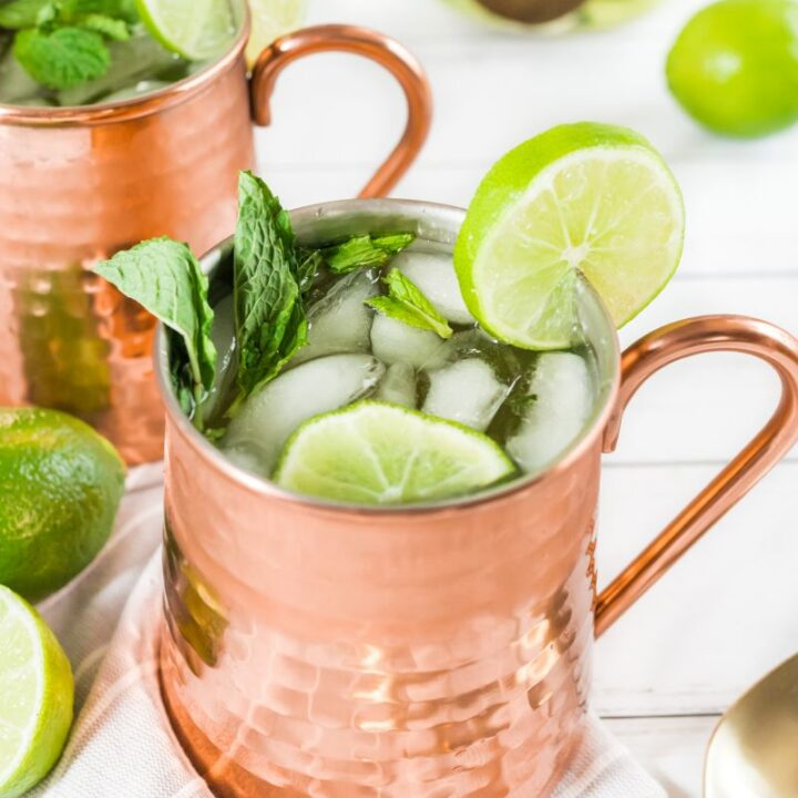 champagne moscow mules garnished with mint and lime