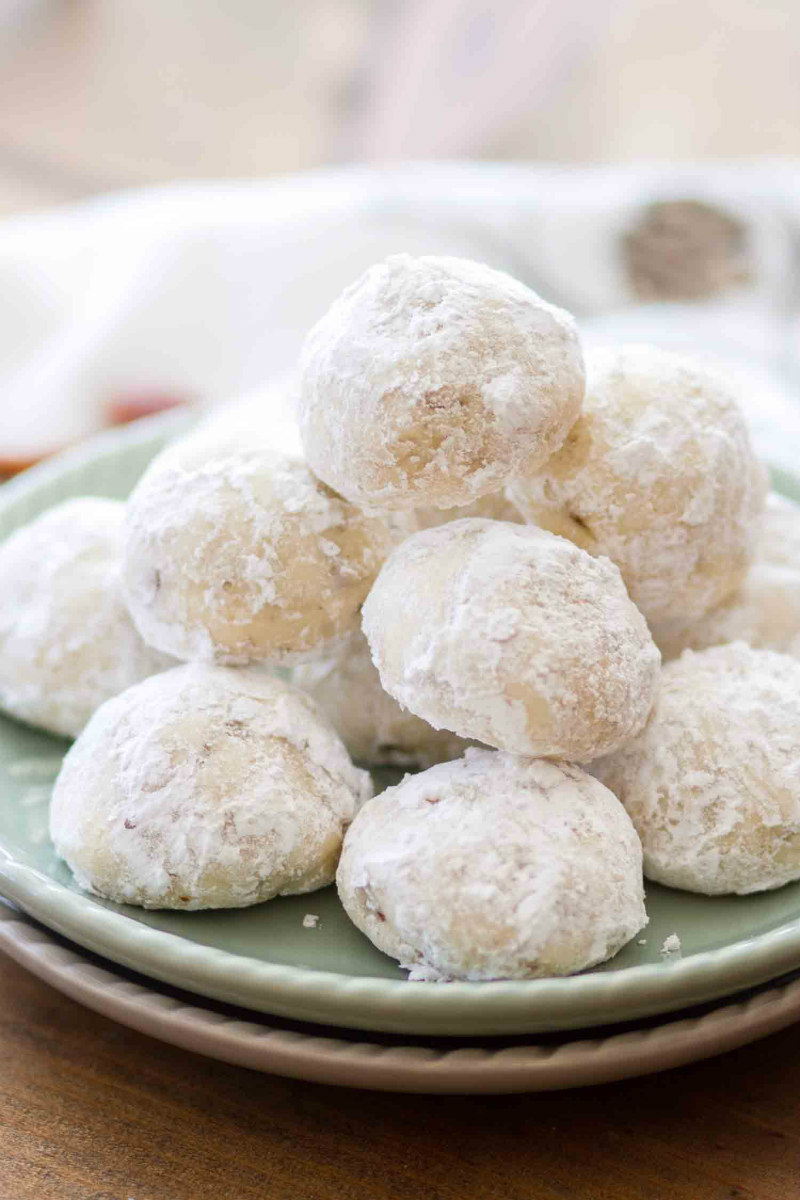 classic snowball cookies on a plate