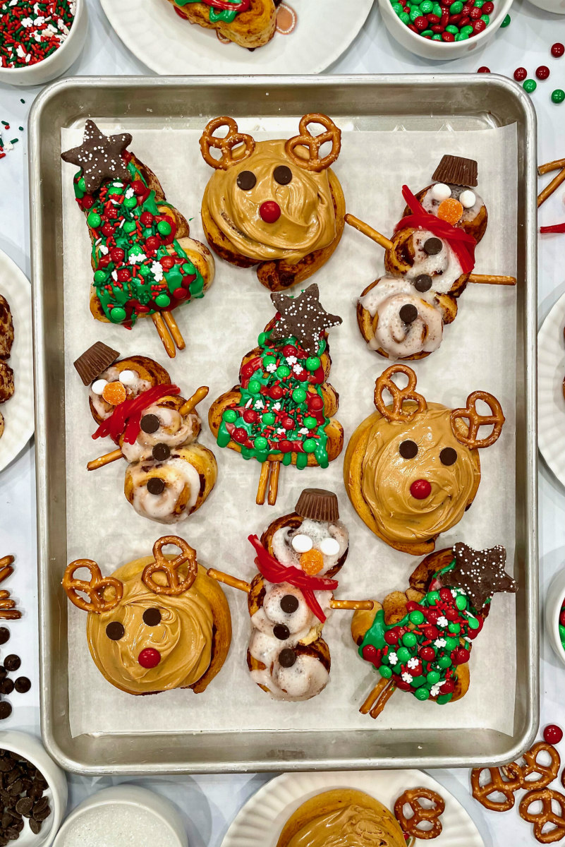 cinnamon rolls decorated as christmas shapes