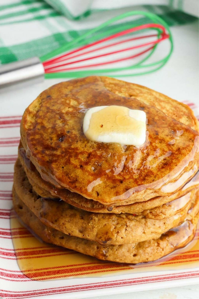 stack of gingerbread pancakes with butter and syrup