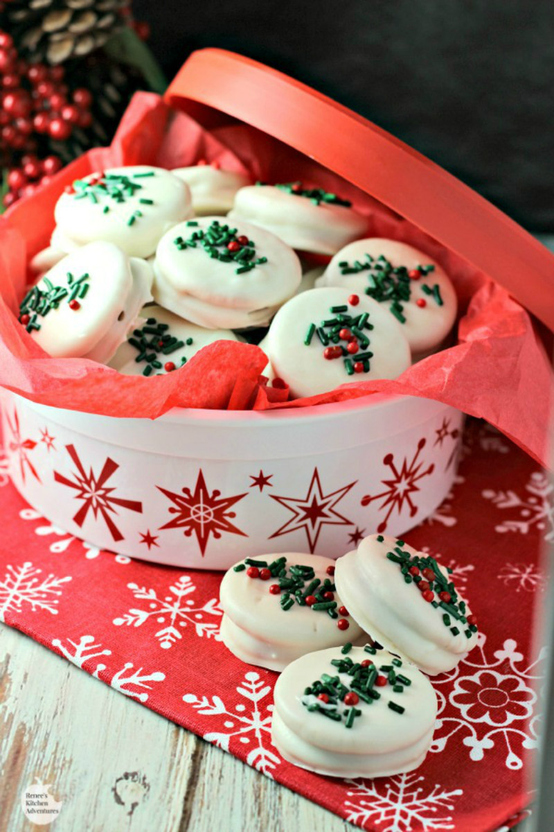 tin full of white chocolate covered gingerbread oreos