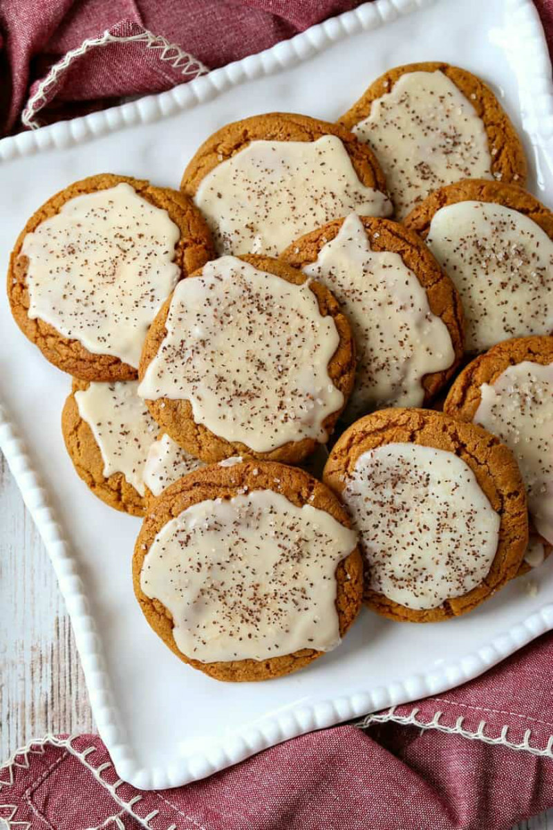 bourbon iced molasses cookies on a white platter