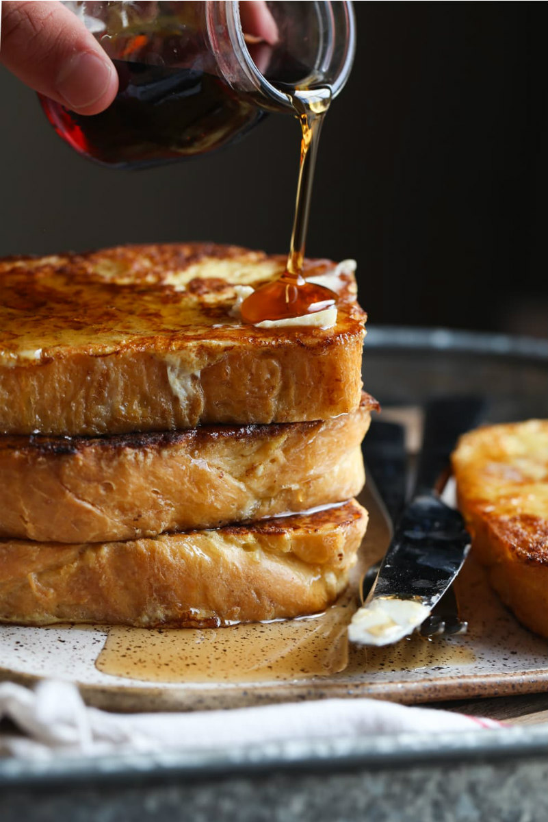 stack of brioche french toast with syrup