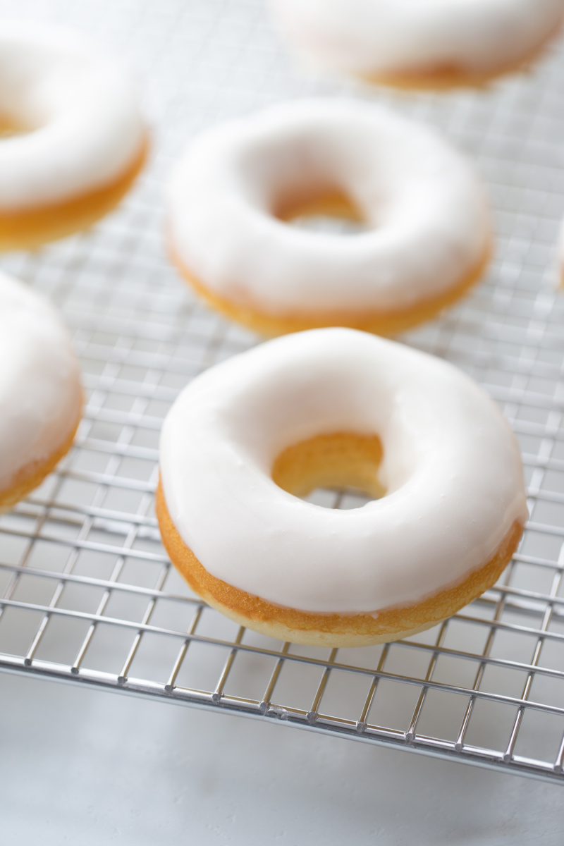baked glazed doughnuts on a cooling rack