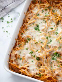 Baked Spaghetti Casserole in white baking dish