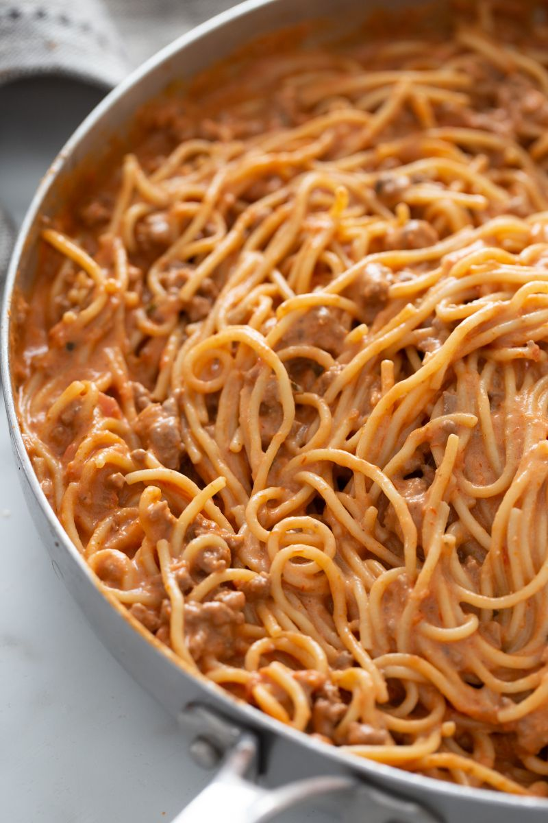 spaghetti with sauce in skillet