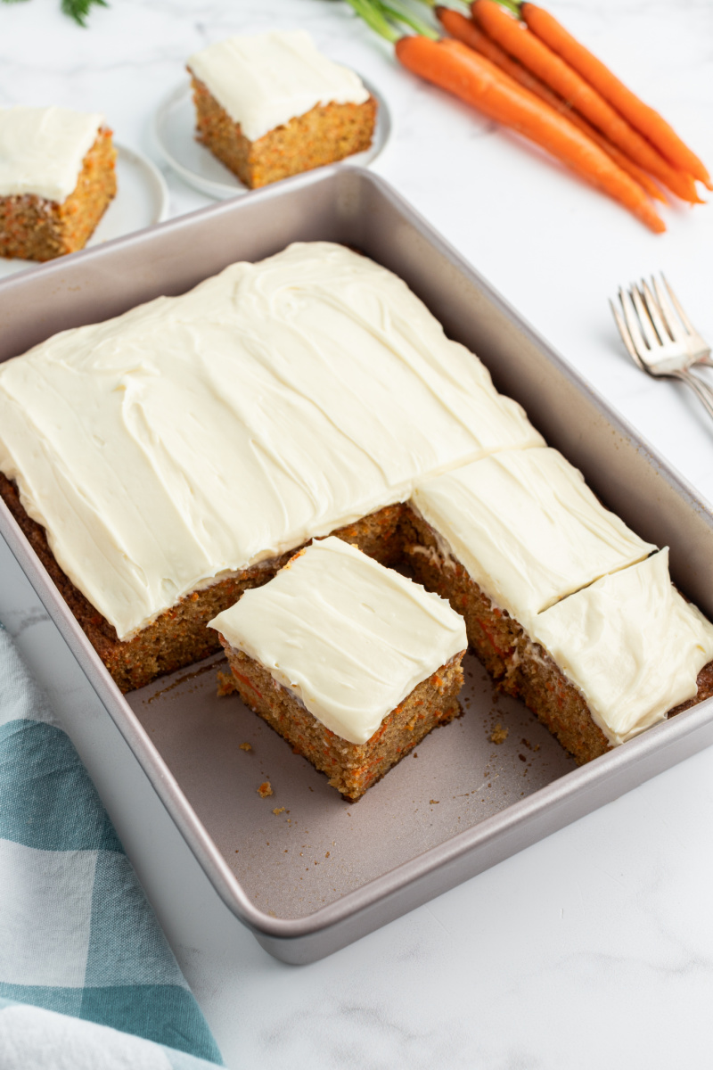 carrot cake in a pan with cream cheese frosting