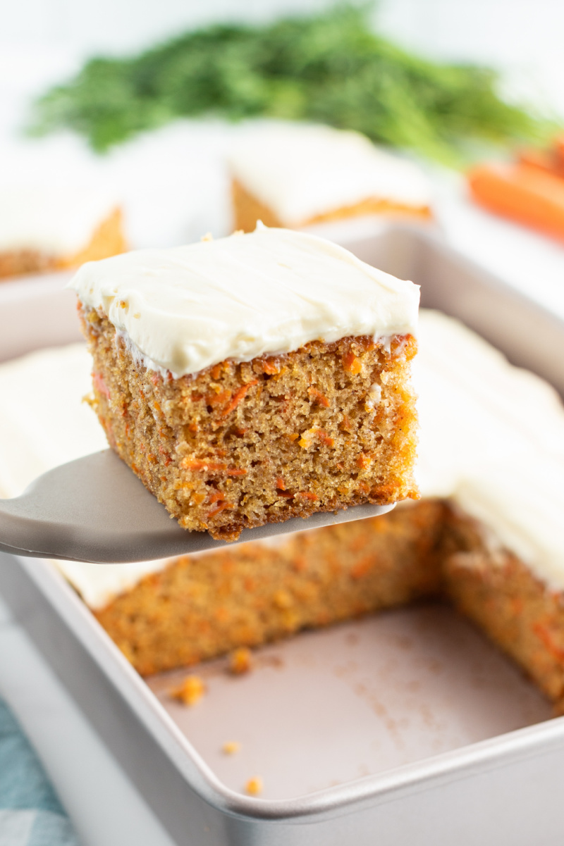 slice of carrot cake being served