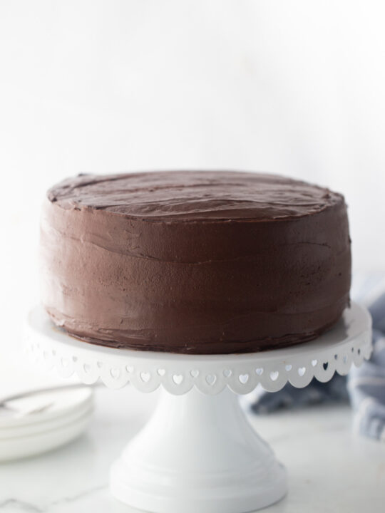 chocolate cake on a white cake stand