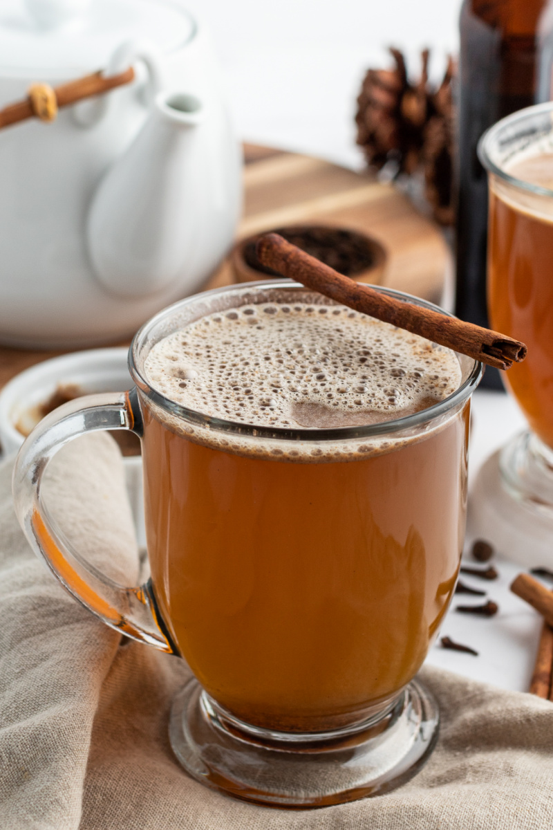 hot buttered rum garnished with cinnamon stick