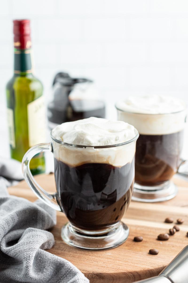 Irish coffee in glass mug with cream on top
