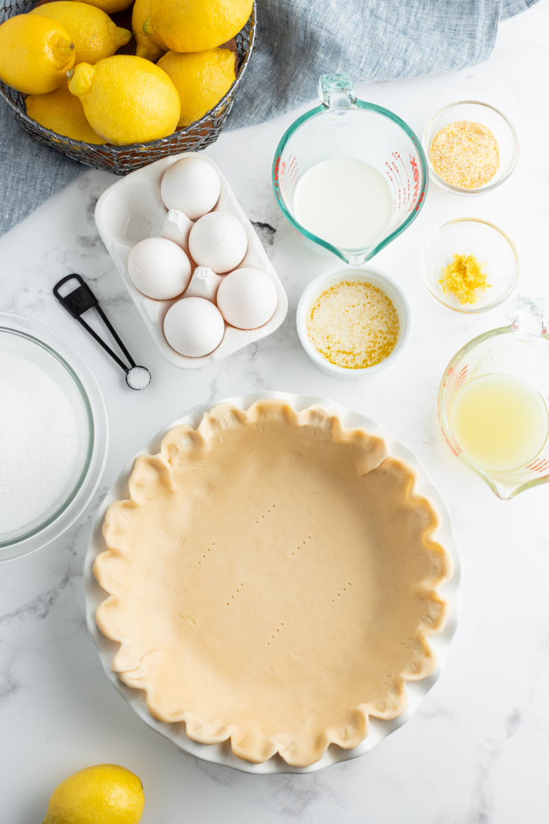 pie crust and ingredients displayed for lemon pie