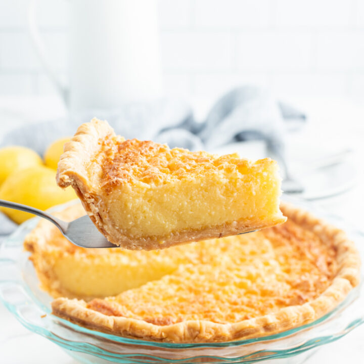 serving taking slice out of lemon chess pie