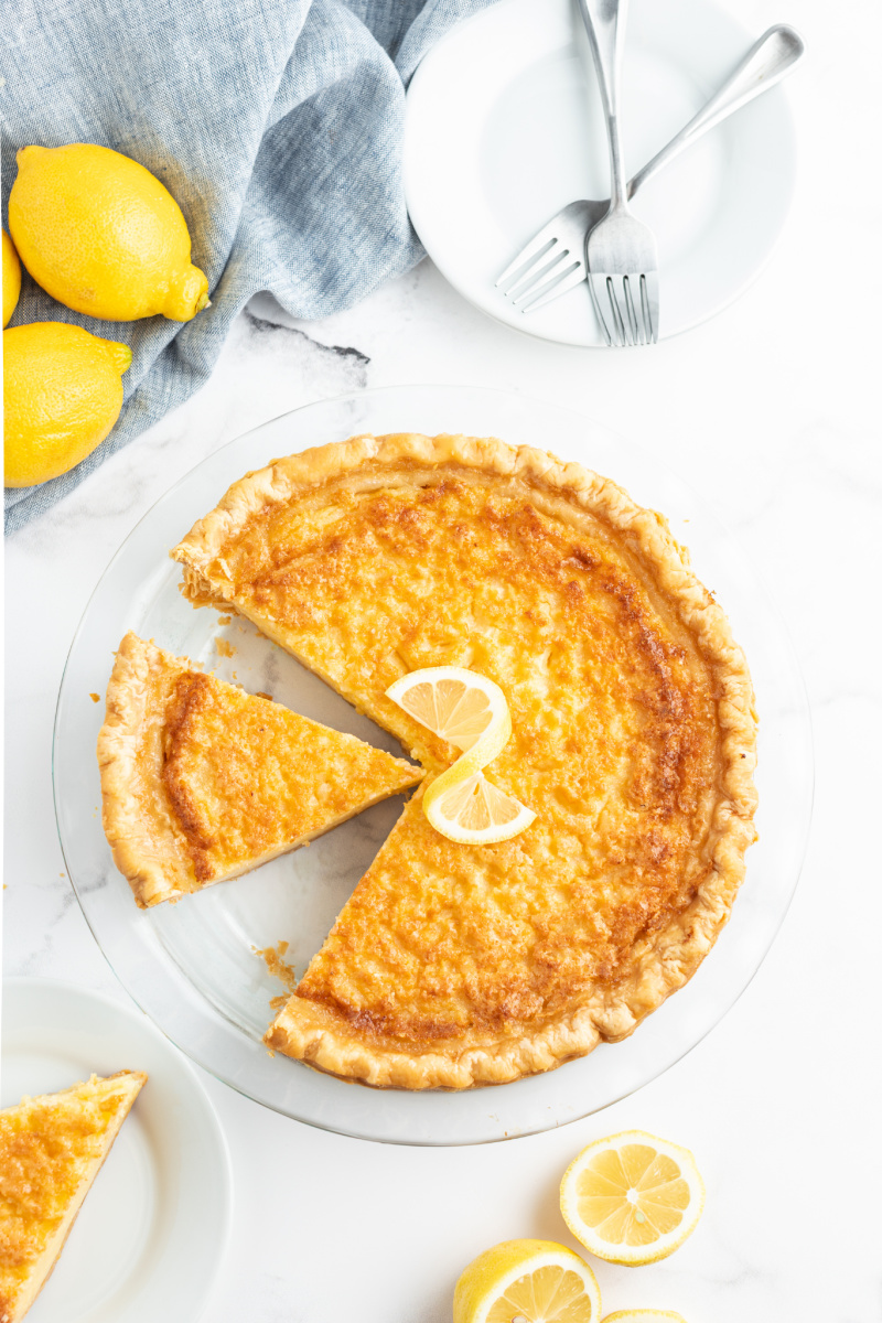 lemon chess pie with slice cut out it