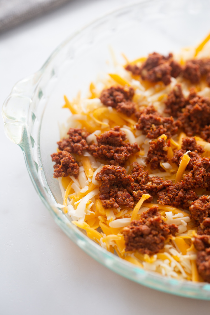 cheese and chorizo in a dish