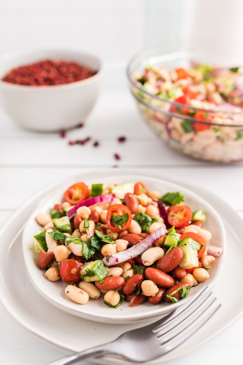serving of three bean salad on a white plate
