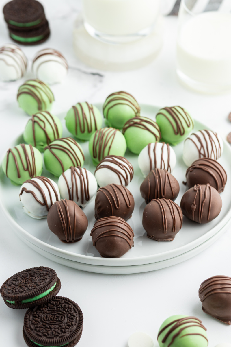 chocolate mint oreo truffles on a white plate