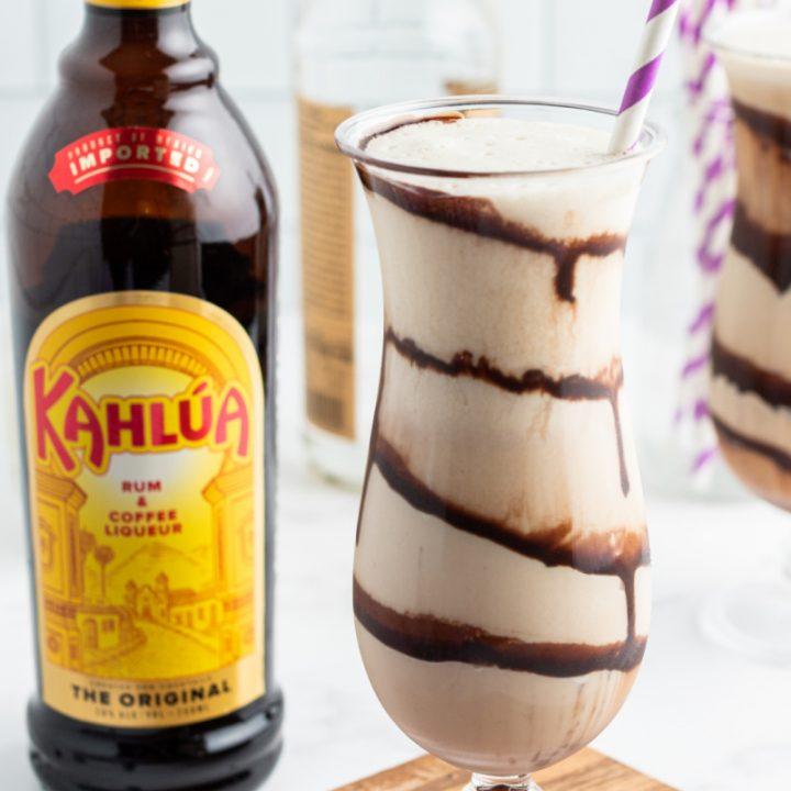 frozen mudslide in hurricane glass with a kahlua bottle