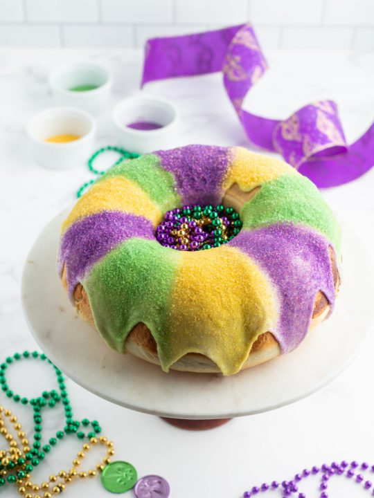 king cake with glaze and colored sugars