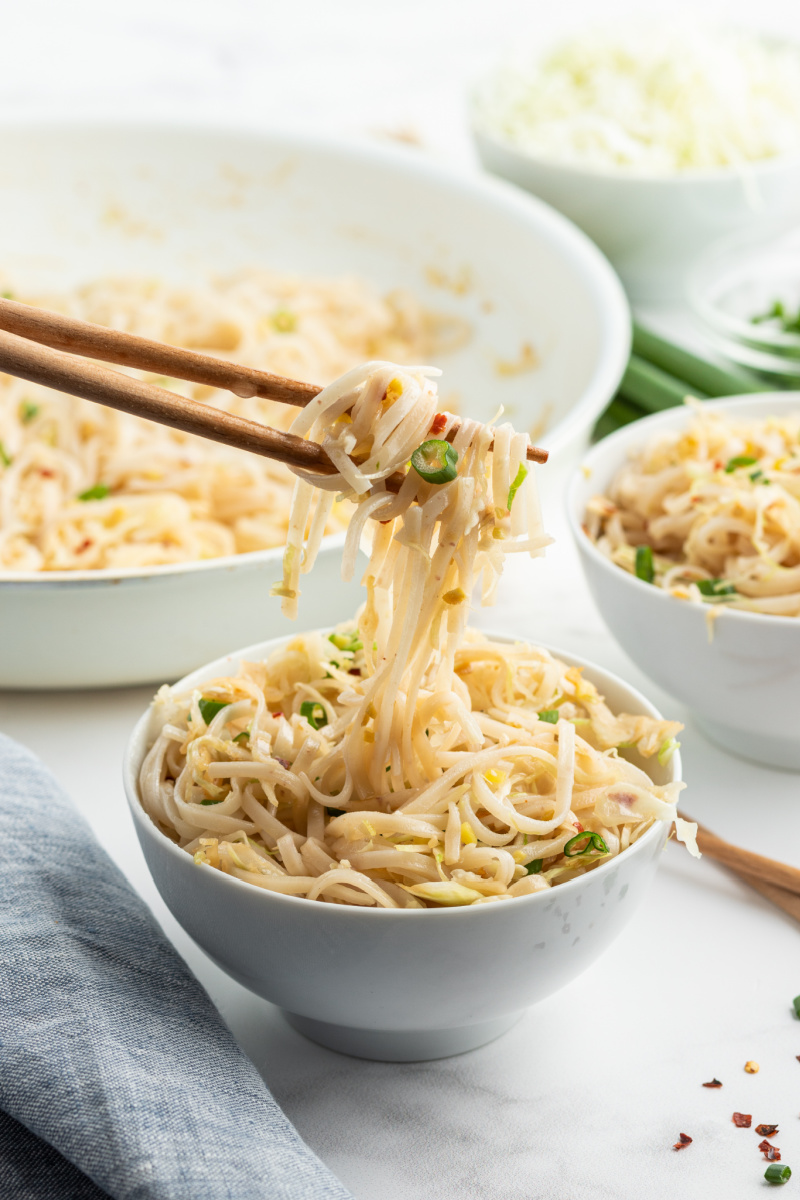 chopsticks picking up noodles out of bowl