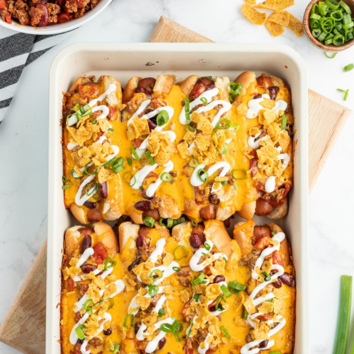 baked chili dogs in white casserole dish