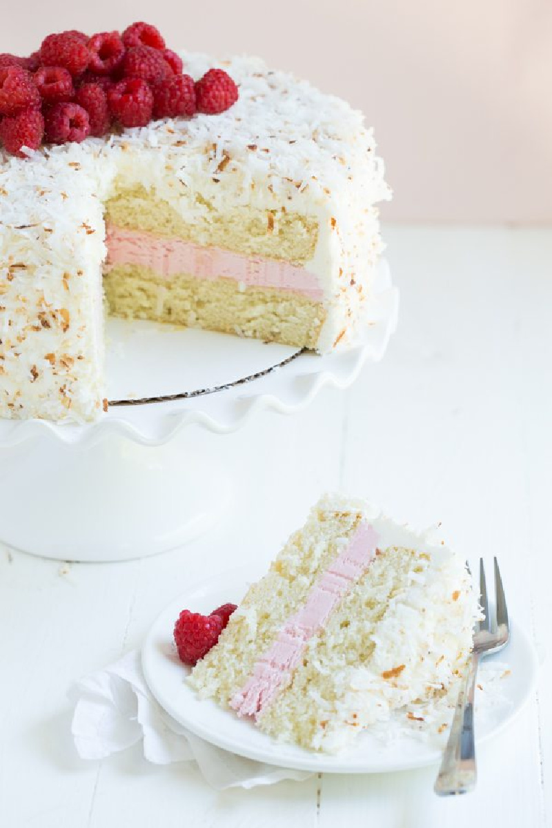 coconut cake and cake slice on plate