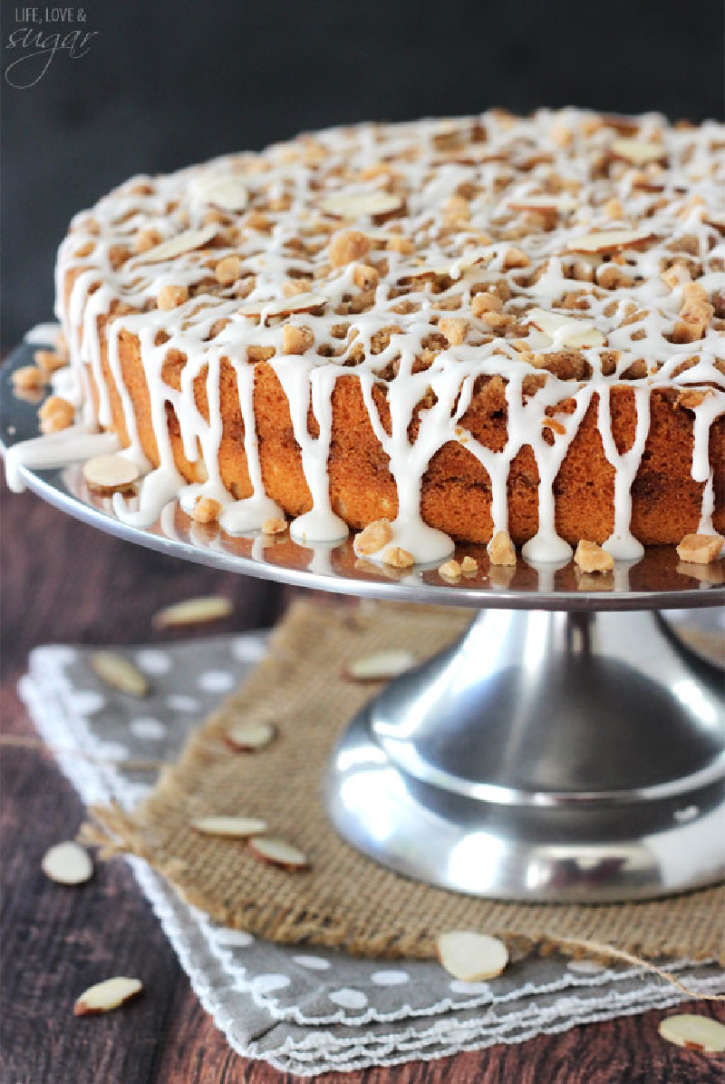 toffee almond streusel coffee cake on metal cake stand
