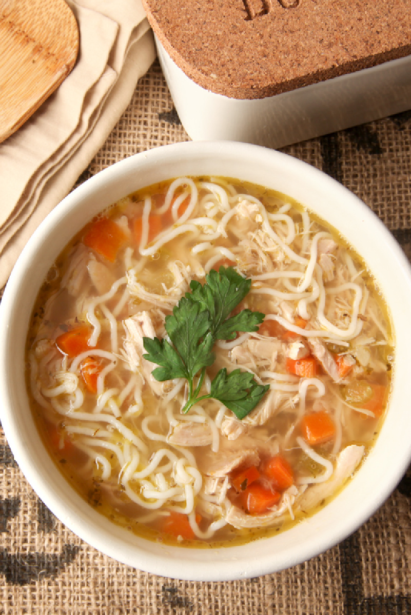 Low Carb Chicken Noodle Soup in a white bowl