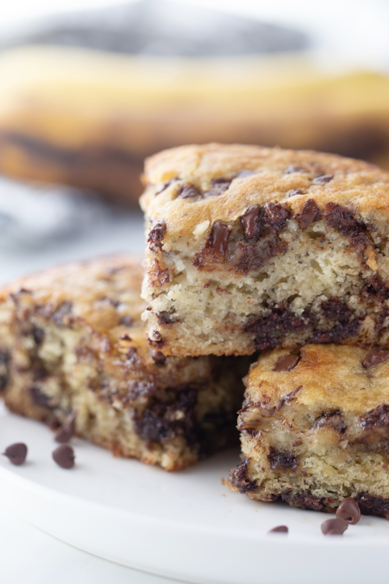 three pieces of banana chocolate chip snack cake stacked on platter