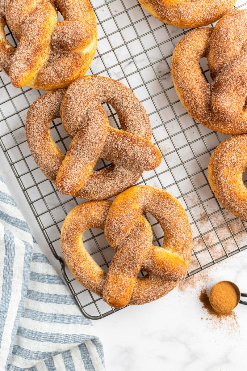 cinnamon sugar soft pretzels on a cooling rack