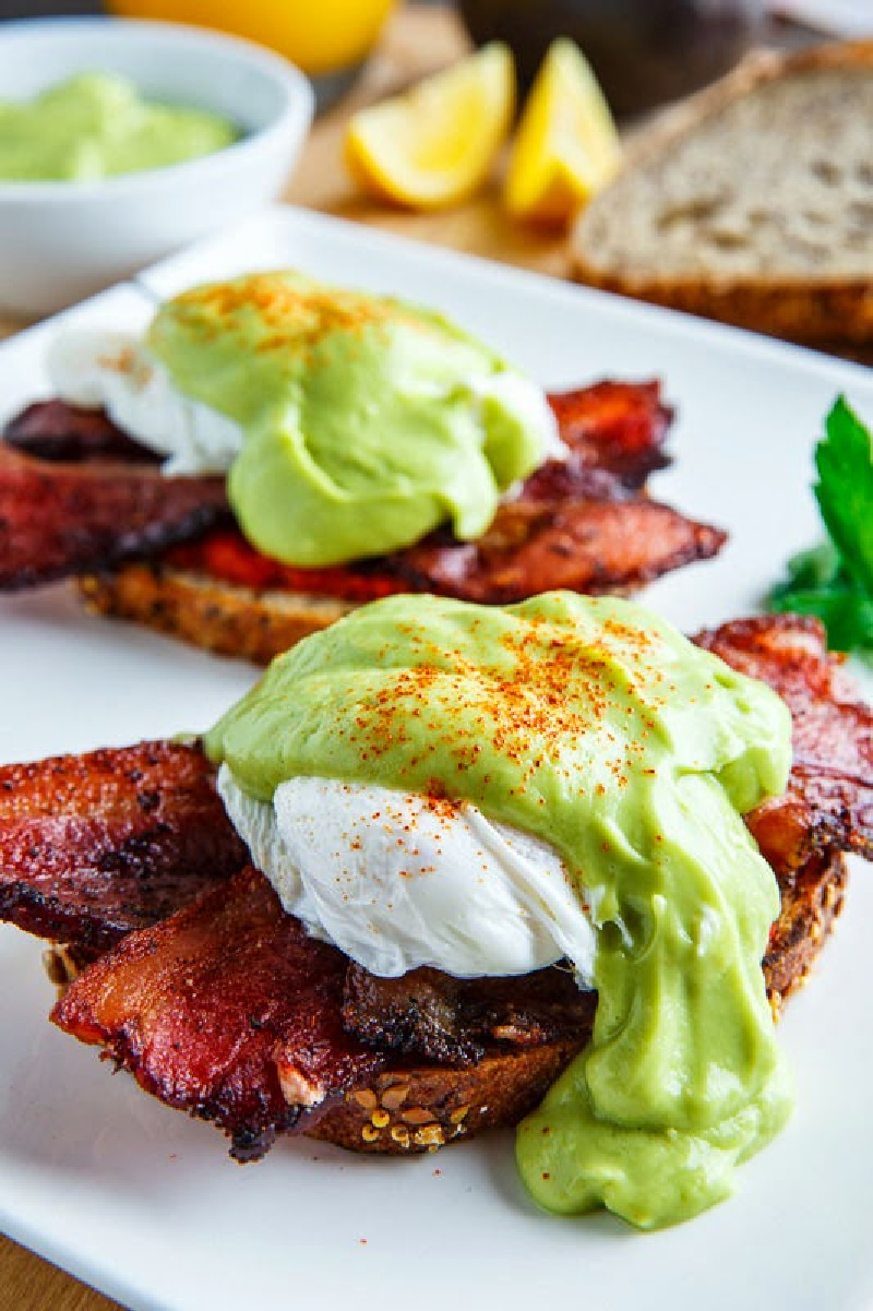 bacon eggs benedict with avocado hollandaise sauce