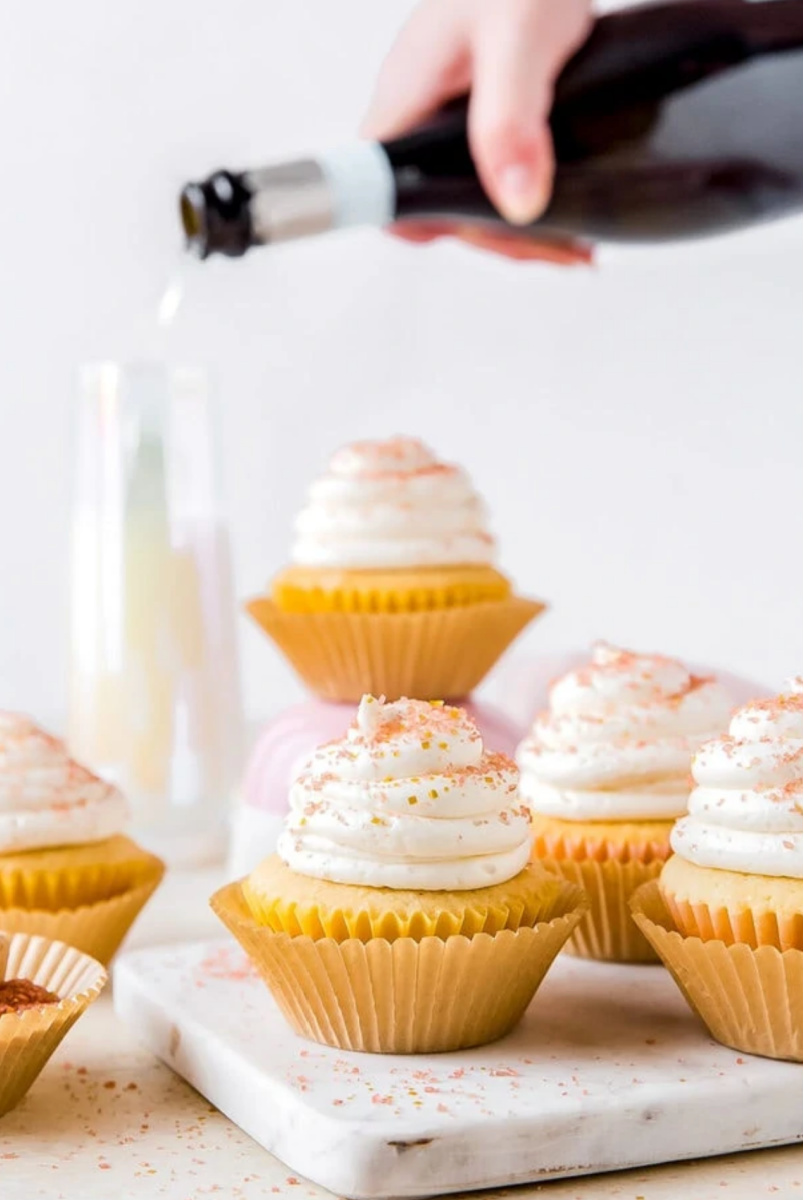 Champagne Cupcakes with champagne pouring in background