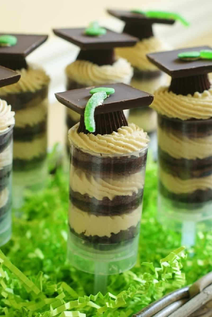 Graduation hats on top of chocolate peanut butter cup push pops