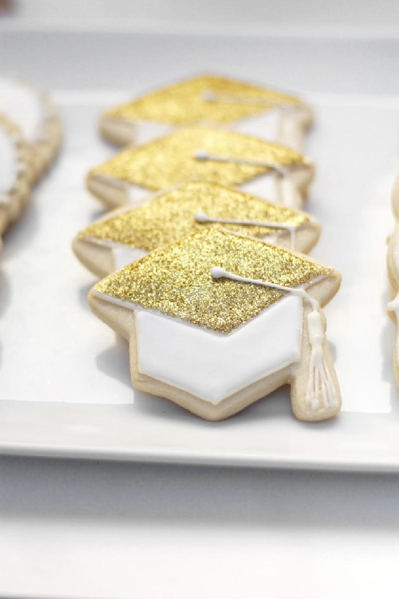 Graduation Hat Cookies on white platter