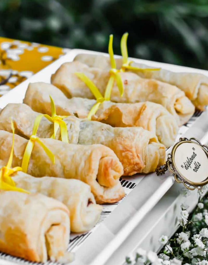 Puff pastry and chocolate diploma rolls on white platter