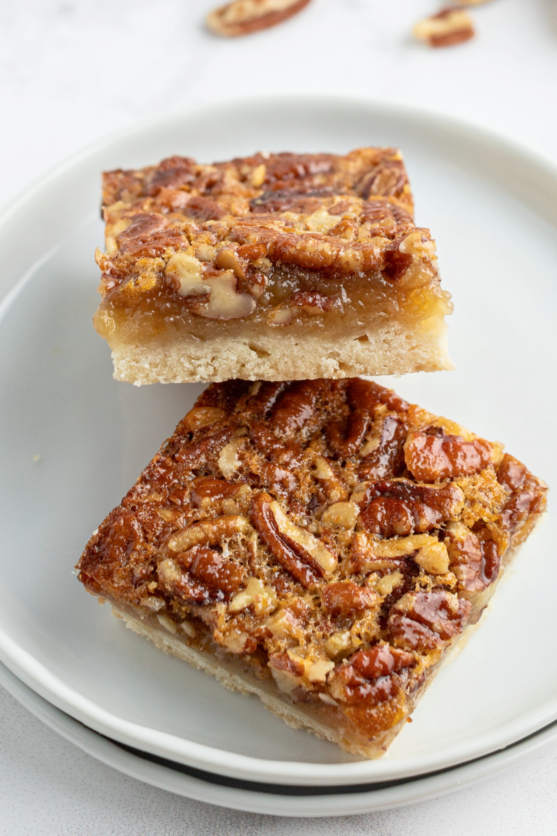 two pecan pie bars on white plate