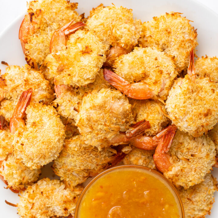 coconut shrimp in a bowl with sauce