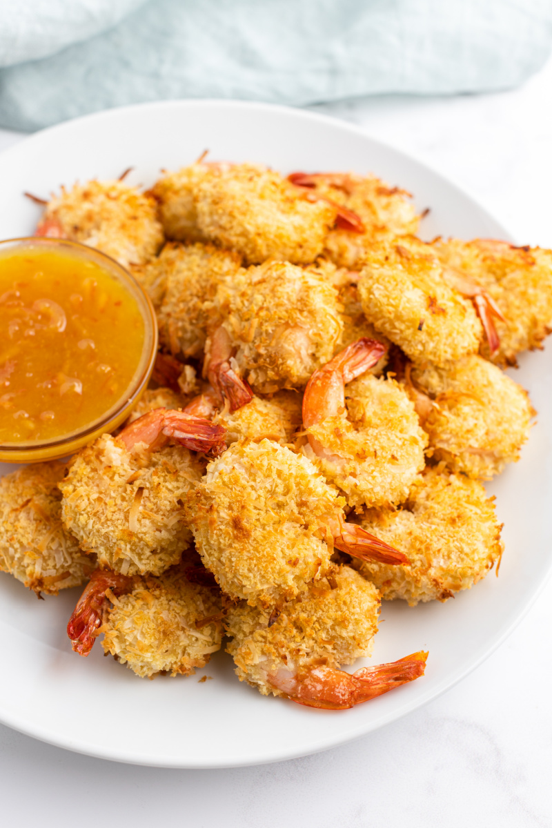 baked coconut shrimp with bowl of sauce