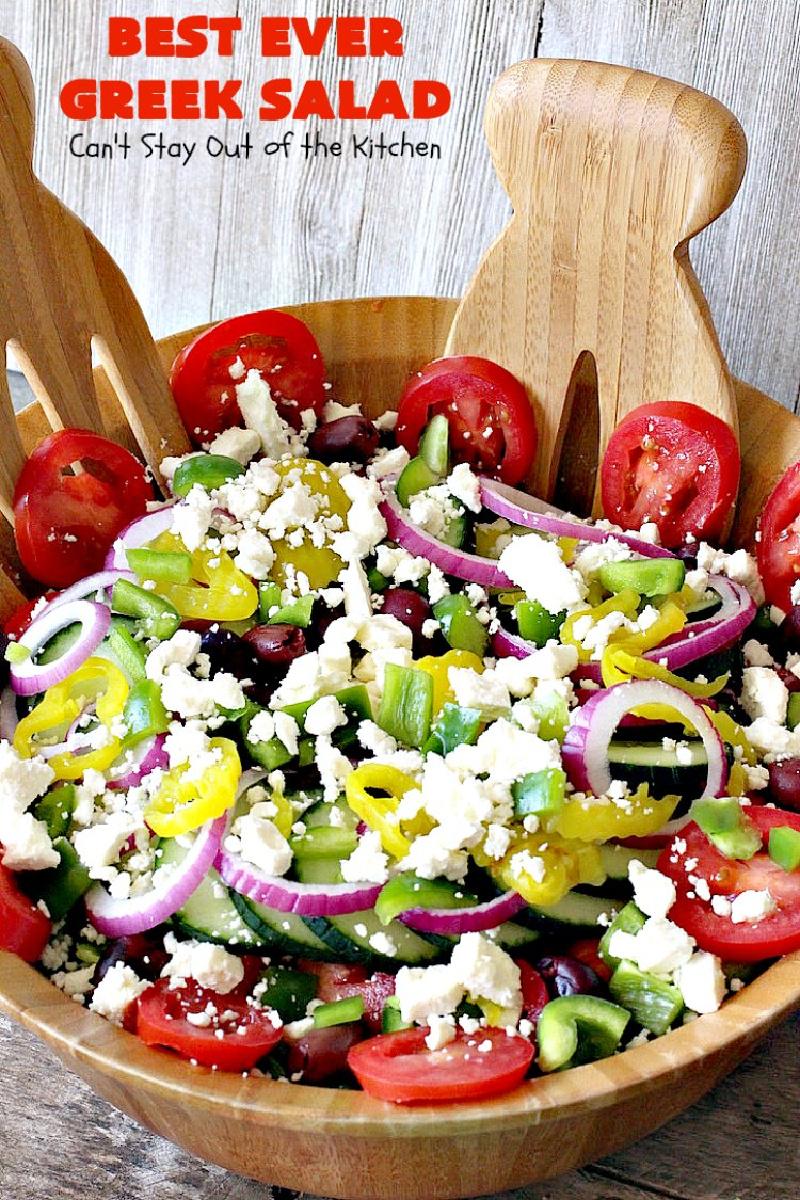 greek salad in wood bowl with servers