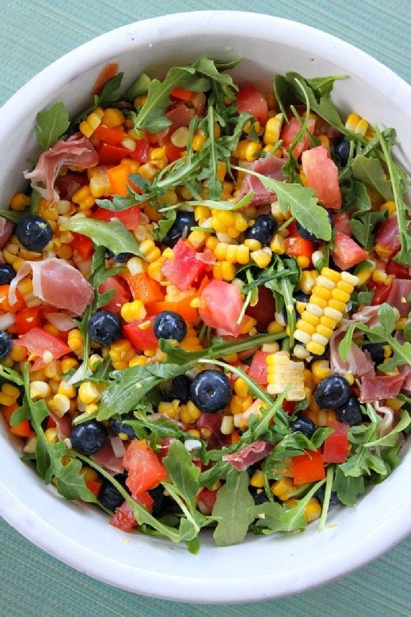 blueberry corn salad in white bowl