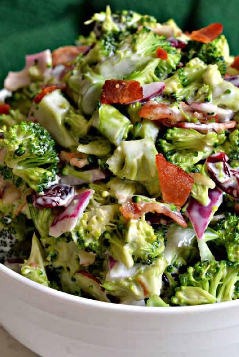 broccoli bacon salad in white bowl