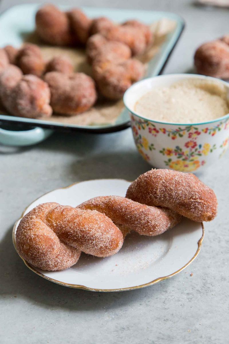 cinnamon sugar twist doughnut on a white plate
