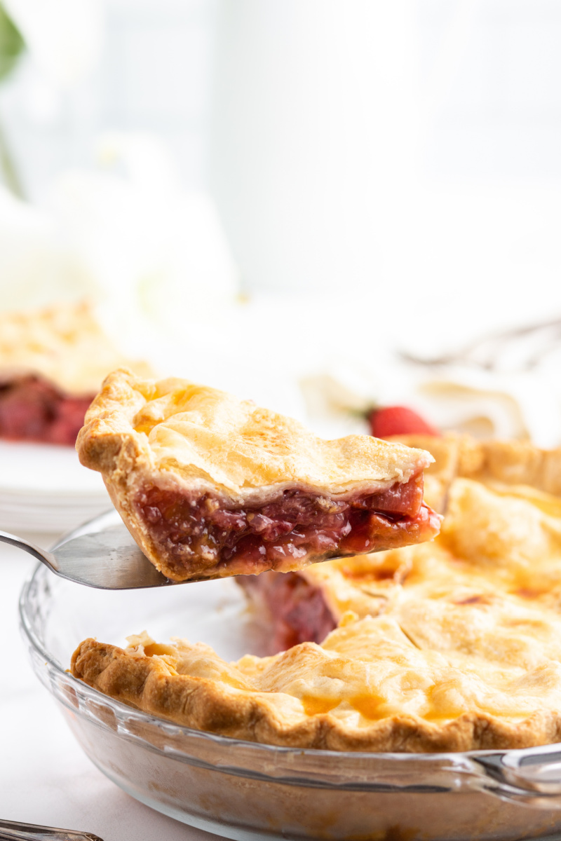 pie server lifting out a slice of easy strawberry rhubarb pie
