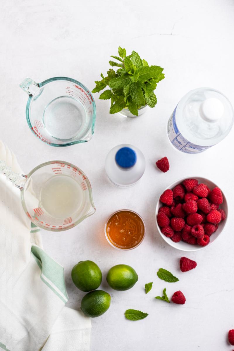 ingredients displayed for honey raspberry mojitos
