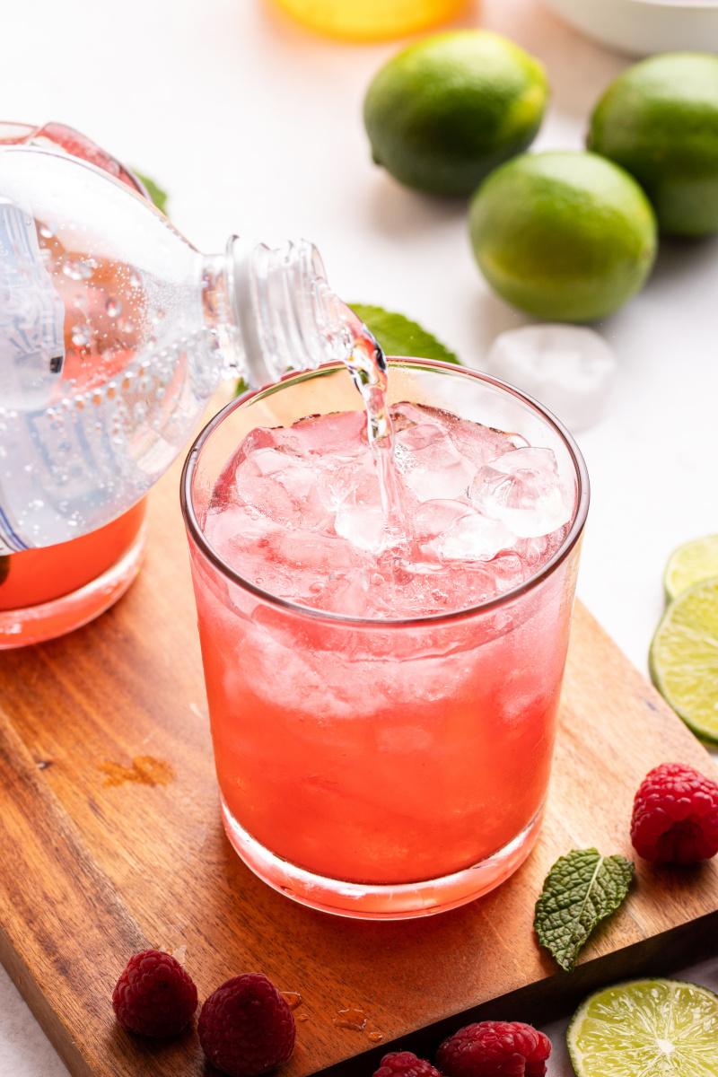 adding club soda to cocktail