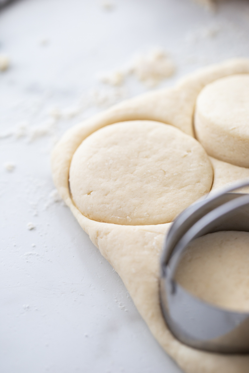 biscuits punching out of biscuit dough