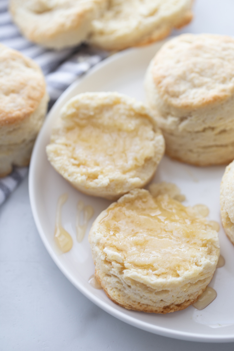 biscuits cut in half with butter