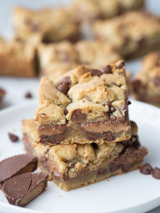 two reeses stuffed chocolate chip cookie bars stacked